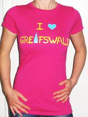 I love Greifswald-Damenshirt, pink (Melisande) mit gelber Schrift und blauem Herz/Turm.