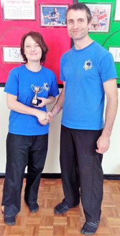 Shui Tao Internal Martial Arts student receiving a trophy after winning a competition
