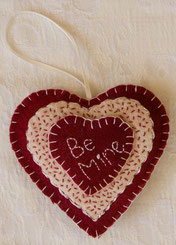 Wool applique valentine ornament from 100% hand-dyed wool.