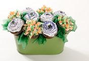 Blumengesteck aus Cupcakes als Tischdekoration