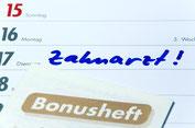 """Kalender mit Eintrag """"Zahnarzt"""" Zahnärztliches Bonusheft"""