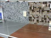 Two backsplashes, one with pebbles and one with a glass and stone mosaic