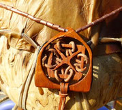 a Celtic knot in wood and rope on the Survivor Drum