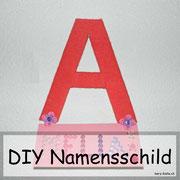 DIY Namensschild aus Wolle für die Zimmertür - eine tolle Deko für die Kleinsten