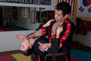Grandmaster demonstrating self-defense.