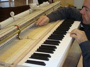 Réglage de la chasse d'une mécanique piano à queue