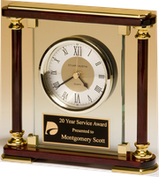 Traditional glass and rosewood piano-finish clock with gold metal accents.