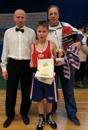 К.Рудаковский(в центре) и тренер А.Чуйко(справа)