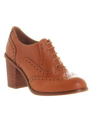 Tan heeled brogue shoes
