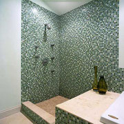 Glass mosaic tiles on shower walls
