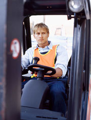 A fork lift driver operating the fork lift