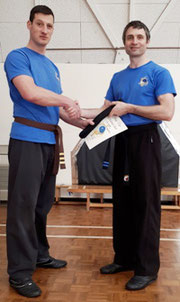 Shui Tao Internal Martial Arts student being awarded his black belt