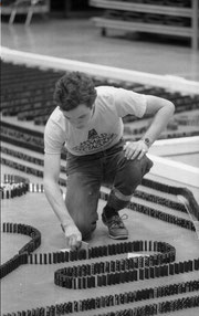 Michael Cairney removing a safety stop before toppling 169,713 dominoes in 1979, achieving a new world record. Photo Ⓒ Dennis E. Powell (http://www.flickr.com/photos/depscribe/collections/), used by permission.