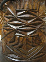 Stem of a beautifully carved djembe in Guinea