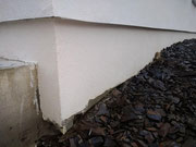 bad detail of finishing external wall insulation at ground level