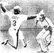 Manny Trillo waits as the Expos' Rodney Scott steals second.