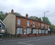 Terraced houses on the Warwick Road © J Thomas licensed for reuse under this Creative Commons Licence: : Attribution-Share Alike 2.0 Generic. Geograph OS reference SP0984.