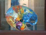 Schaufenster-Werbung für Franck Carron
