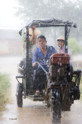 Farmers in the rain. Always smiling.