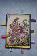 Label of knuffeldoekjes; Flowerfairies. De achterkant is van cremekleurige badstof. Artikelcode LKN045. Prijs 9,50 exclusief verzendkosten.