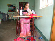 This beneficiary started to work from her home as a tailor. For buying the machine she received a small intrest credit.