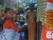 This lady opned a small shop by taking a loan through the Income Generation Programme.