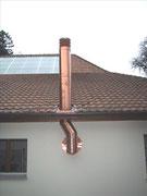 Abgasanlage von Cheminéeofen an Fassade Fisa AG, Kaminbau