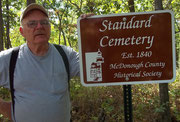 Mike Black  from Industry, a local cemetery historian, accepts a new sign for the Standard Cemetery donated by the McDonough County Historical Society.