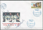 Flown cover Sojus TM-34, orig.signed by complete crew Shuttleworth (Second Spacetoutist, first african astronaut), Gidsenko and Vittorio with ISS postmark dated 27.04.2002 docking TM-34 to ISS and postmark 5.05.2002 undocking of TM-33 from ISS, 160 exist
