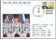 Sojus TMA-07M launch mission cover with photograph of the complete crew
