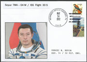 Sojus TMA-07M launch mission cover with photograph of Rewin