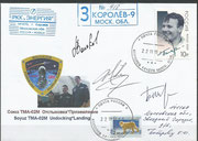 Sojus TMA-02M undocking cover orig.signed by complete crew Wolkow, Fossum and Furukawa