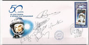 Flown cover with the ISS, orig signed by complete crew Sojus TMA-08M Winogradow, Missurkin and Cassidy and by complete crew Sojus TMA-09M Jurtschichin, Parmitano and Nyberg, two strikes, blue oct. cancel of ISS and new strike 16.6.2013 of ISS russia part