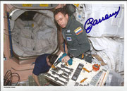 S.Soljotin is working with tools in the ISS, orig. signed by Soljotin