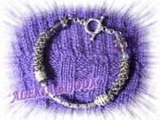Articolo n. B024 Bracciale rigido con spirali in perline violetto e argento