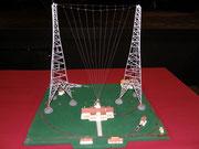 Maquette de la station à côté de 2 pylones (250m)