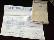 Kassenbeleg und Amtliches Prüfzeugnis vom Prüfinstitut für Zeitmessgeräte des Deutschen Amtes für Meßwesen und Warenprüfung
