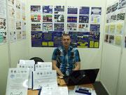 Роман Александрович работает в павильоне.