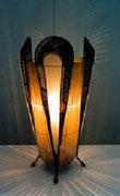 """1999 """"DECO'"""" Un portaombrelli molto kitch, un po' decò, con l'aggiunta di quattro fette di vetro smerigliato e di un pezzo di un vechio lampadario si trasforma in una lampada da tavolo."""