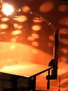 """2002 """" BICOMETA""""  Lieve variazione della mia vecchia lampada """"1-in-2"""", bicometa nasce grazie al ritrovamento di un meraviglioso morsettone il legno l'effetto di cielo stellato che provoca quando è accesa le ha meritato il nome"""