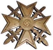 Krzyż Hiszpański-Wymagania  Złoty z diamentami  * Szczególne akty bohaterstwa i odwagi  Złoty z mieczami  * również akty bohaterstwa   Srebrny z mieczami  * Udział w pomocy dla Hiszpanii, udział w walkach  Srebrny za pomoc w zaopatrywaniu gen. Franco