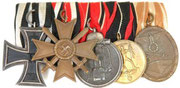 1914 Iron Cross 2nd Class, War Merit Cross 2nd Class for combatants, Eastern Front medal, Sudetenland Annexation medal and West Wall medal