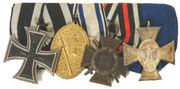 1914 Iron Cross 2nd class, Gold Kyffhauserbund medal, Bronze 1914-18 Honor Cross and a Police Service Cross 2nd class (18 Years)