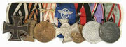 1914 Iron Cross 2nd Class, Hindenburg Cross, Austrian WWI Service Medal, Police 18 year Service Cross, Sudetenland Medal, Luftschutz Service Medal and Austro-Hungarian WWI Service Medal