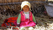 One of the cute local babies on the floating village, Lake Titicaca, Puno