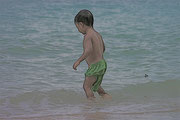 young boy playing in the water at White Beach