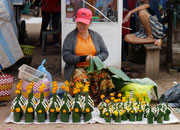 lady selling flowers on the street in Pakse, Laos
