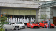 some nice automobiles outside the Fullerton Hotel, Singapore