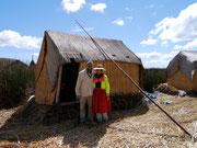 Dingo and Fudgie in local costume on one of the floating villages