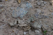 as dirt washes away over time, clothing from those buried reaches the surface